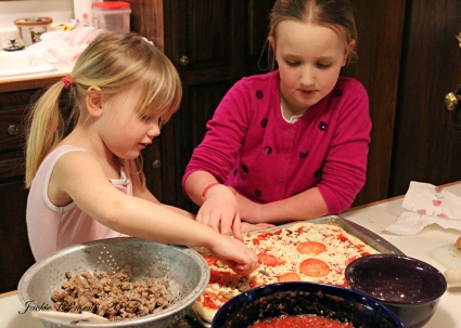 Making their own homemade pizza